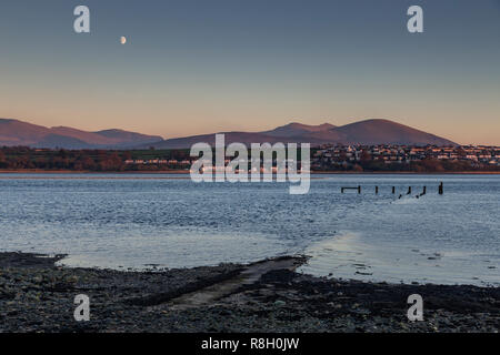 Menai Straits, Anglesey, at sunset with moon - Stock Image