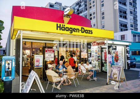 Hollywood Florida Hollywood Beach Boardwalk Haagen-Dazs ice cream shop tables business - Stock Image
