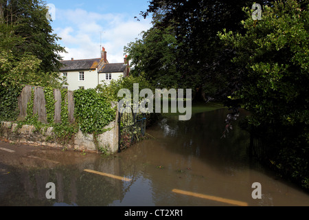 Weymouth Rains Flood Garden in Radipole Lane Prior to the Weymouth Sailing Olympics This Month - Stock Image
