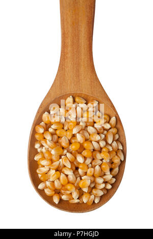 Corn kernels in a wooden spoon isolated on white background - Stock Image