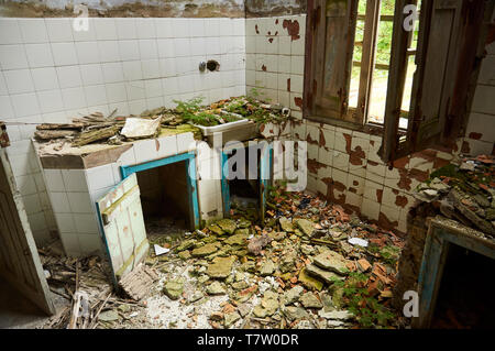 Interior of a room of the ruined facilities at the abandoned Canfranc International railway station (Canfranc, Pyrenees, Huesca, Aragon, Spain) - Stock Image