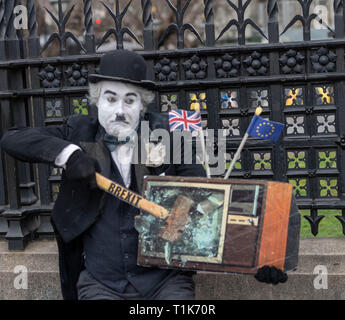London, UK. 27th March 2019, Brexit protesters clowning around dressed as Charlie Chaplin Credit: Ian Davidson/Alamy Live News - Stock Image