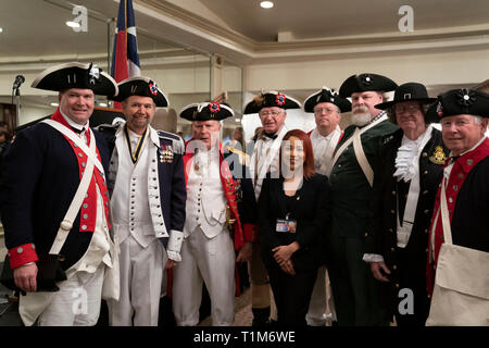 Men in American Revolutionary War-era style costumes pose before marching in the Washington's Birthday Celebration parade through downtown Laredo, TX. - Stock Image