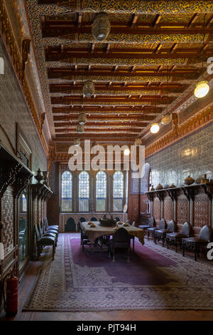 Manial Palace of Prince Mohammed Ali. Dining room at the Residence Building, with ornate wall and ceiling and Big ornate window - Stock Image