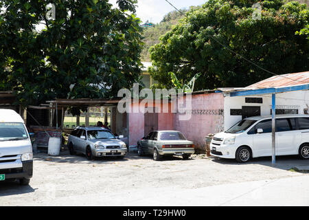 Cars parked in St Lucia, The Caribbean - Stock Image