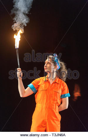 Edinburgh, UK. 10th April, 2019.  Aoife Raleigh demonstrates her skills with fire during the photo call for StrongWomen Science abrand-new circus science showat Edinburgh Science Festival starring two womenscientiststurned circus performers who reveal thescientific secretsbehind theirastounding tricks. Credit: Roger Gaisford/Alamy Live News - Stock Image