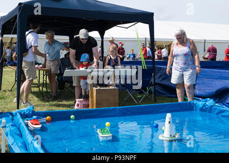 Radio control model boats have a go for kids at Wings and Wheels - Stock Image