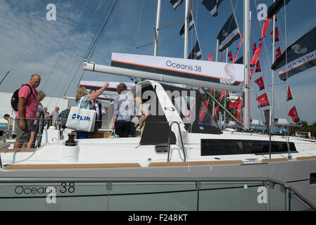 Southampton, UK. 11th September 2015. Southampton Boat Show 2015. Visitors on the Beneteau yacht stand look at an - Stock Image