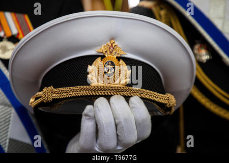 An officer of the Black Sea fleet of the Russian Navy holds a cap in the parade during the celebrations dedicated to the Day of the Black Sea fleet - Stock Image