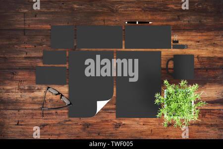 top view of dark branding elements on wooden desktop mockup 3d rendering - Stock Image