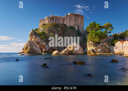 Fort Lovrijenac in Dubrovnic as seen from the beach.  Long exposure to create flat water on a clear bright sunny day. - Stock Image