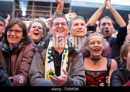 Kaiser Chiefs concert at Elland Road as part of Leeds United's centenary year celebrations. Fans in the crowd - Stock Image