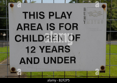 playground bury greater manchester uk england this play area is or children of 12 years and younger preteens sign - Stock Image