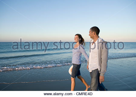 Couple walking by the sea - Stock Image