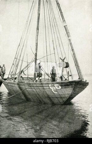 Light craft (or dhow) on the River Nile, Sudan (then part of the British Empire), East Central Africa. - Stock Image