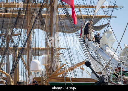 Crew preparing to sails on the bowsprit for the Tall Ships Race 2016. Leg 2 from Lisbon to Cadiz - Stock Image