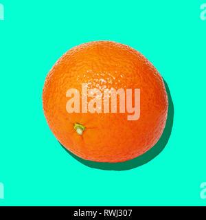 Orange close up on bright blue background. - Stock Image