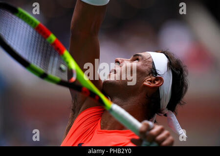 Flushing Meadows, New York - August 31, 2018: US Open Tennis:  Number 1seed Rafael Nadal serving to his opponent Karen Khachanov of Russia during their third round match at the US Open in Flushing Meadows, New York. Credit: Adam Stoltman/Alamy Live News - Stock Image