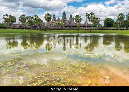 Angkor Wat temple reflected in one of the lakes infront of the temple - Stock Image