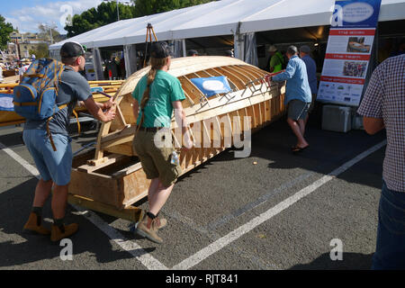 Hobart, Tasmania, Australia, 8 Feb 2019. Shipwrights and apprentices move wooden dinghy that is being hand-built during the Festival undercover in case of rain. The 2019 Australian Wooden Boat Festival celebrates historical and current shipbuilding and is one of the world's most anticipated maritime events. Credit: Suzanne Long/Alamy Live News - Stock Image