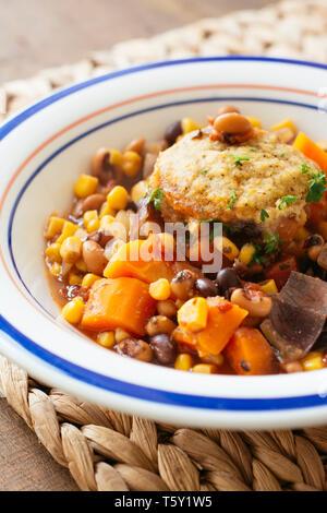Bean Stew with Cornmeal Dumplings - Stock Image
