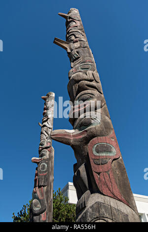 A Tlingit totem pole in Totem park carved by master carver Tommy Joseph in Petersburg, Mitkof Island, Alaska. Petersburg settled by Norwegian immigrant Peter Buschmann is known as Little Norway due to the high percentage of people of Scandinavian origin but was originally an indigenous Tlingit fishing camp. - Stock Image