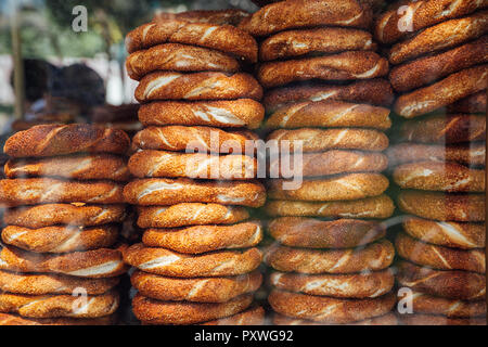 Stacks of simit bread at a street stall in Istanbul, Turkey - Stock Image