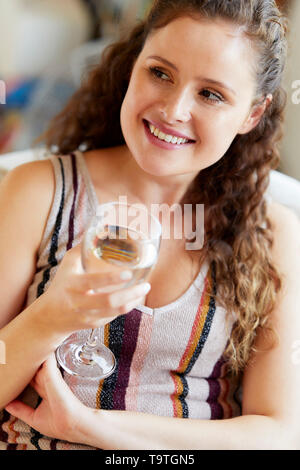 Girl relaxing drinking wine - Stock Image