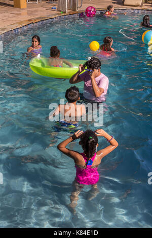 girls and boys, children, swimmers, swimming, swimming pool, freshwater swimming pool, pool party, Castro Valley, Alameda County, California, United - Stock Image