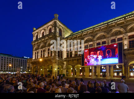 Staatsoper, people look at the transfer of the current performance of the opera on a large screen in front of the Opera, Wien, Vienna, 01. Old Town, W - Stock Image