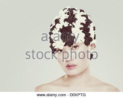 Young woman wearing retro swimming cap - Stock Image