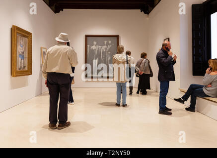 Picasso Museum Malaga - visitors looking at paintings, Museo Picasso, Malaga Andalusia Spain - Stock Image