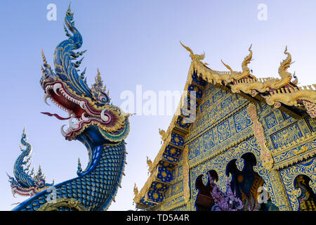 Front entrance of Wat Rong Suea Ten (Blue Temple) in Chiang Rai, Thailand, Southeast Asia, Asia - Stock Image