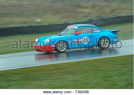 Dunfermline, UK. 7th April, 2019. 49 Raymond BoydsÕs Porsche 911 Turbo during qualifying for a Scottish Classic Sports and Saloons Championship race at Knockhill Circuit. During a wet and misty start to the Scottish Championship Car Racing season organised by the SMRC (Scottish Motor Racing Club) at Knockhill. Credit: Roger Gaisford/Alamy Live News - Stock Image
