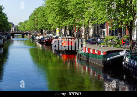 Boats on the Keizersgracht canal in Amsterdam, Netherlands - Stock Image