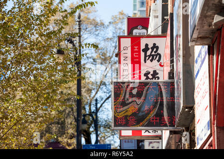 MONTREAL, CANADA - NOVEMBER 4, 2018: Signs of Chinese and Asian shops taken in the Montreal chinatown, in Quebec. it is the Chinese ethnic district of - Stock Image