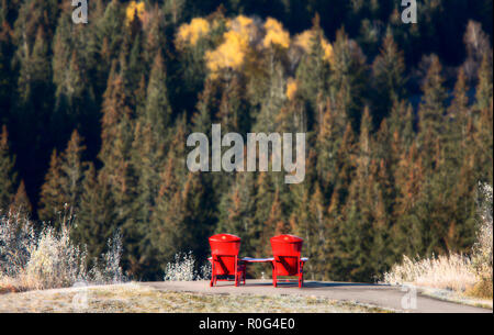 Cypress Hills First Snowfall Alberta Red Cottage Chairs - Stock Image
