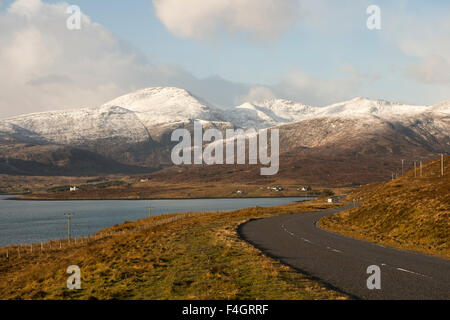 View over Loch Seaforth to snow covered Harris mountains - Stock Image