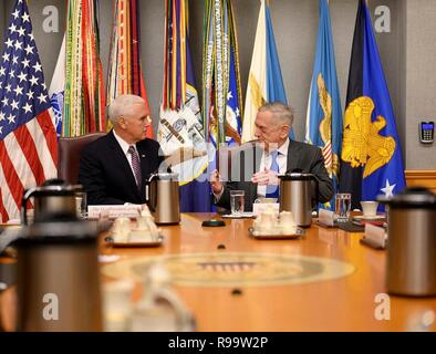 U.S. Secretary of Defense James Mattis, right, meets with Vice President Mike Pence at the Pentagon December 19, 2018 in Arlington, Virginia. Mattis announced his resignation December 20th in protest of President Trumps announcement to withdraw American forces from Syria and his rejection of international alliances. - Stock Image