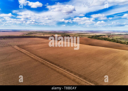 Plowed cultivated farmland on remote farm near Moree agricultural rural town in outback Australia on top of flat plains of artesian basin. - Stock Image