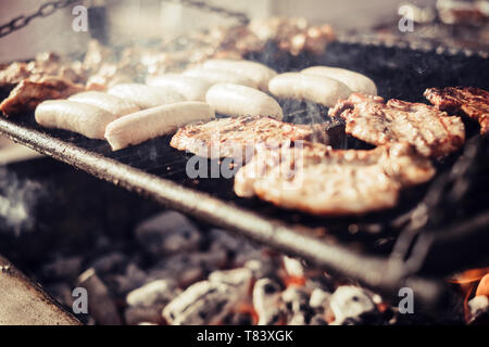 Close up of barbecue meat grill with fire and carbon . delicious food to eta in friendship celebration outdoor - Stock Image