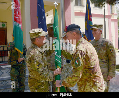 KABUL, Afghanistan (September 2, 2018) -- Italian Army Gen. Riccardo Marchio, Joint Forces Command Brunssum commander, passes the Resolute Support guidon to Gen. Scott Miller, Resolute Support Mission commander, during a change of command ceremony in Kabul, Afghanistan, September 2, 2018. (U.S. Air Force photo by Tech. Sgt. Sharida Jackson) - Stock Image