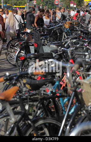 Copenhagen, Denmark, parked bicycles and pedestrians - Stock Image