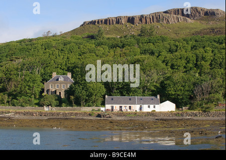 Canna House and cottages on the Isle of Canna, Small Isles, Scotland. - Stock Image