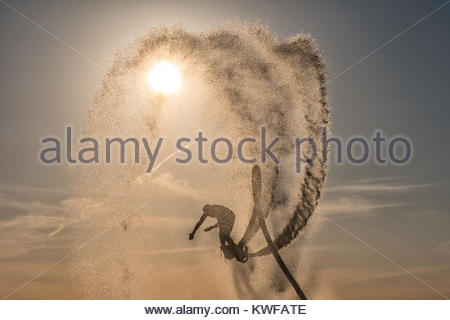 Flyboarding against beautiful sky - Stock Image