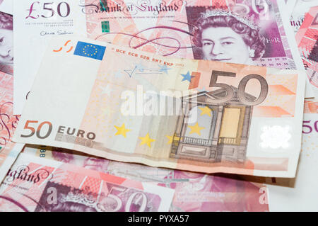 UK and EUR currency, 50 pounds and 50 euros - Stock Image