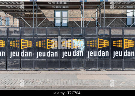 Scaffolding with company name Jeudan, largest listed real estate company in Denmark - Stock Image