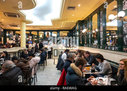 Famous Madrid Chocolateria San Gines, Chocolatería San Ginés, packed in winter with people eating churros and drinking hot chocolate. Madrid Spain. - Stock Image