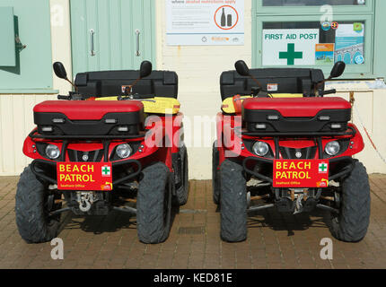 Beach patrol quad bikes at the seafront office / first aid post, Brighton, East Sussex, England, UK - Stock Image