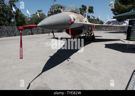 Jerusalem, Israel. 26th June, 2019. An F-16, nicknamed Barak in the Israel Air Force, stands on display. Operational in the IAF since 1980, it is a multi functional fighter which serves in attack and interception missions. 'Our IDF' exhibition opens at the First Station in Jerusalem featuring armored combat vehicles, an F16 fighter jet, an audio video presentation and combat simulators based on virtual reality. The conscription based IDF, considered in Israel the 'people's army', opens its doors to the public free of charge fulfilling its role in creating a close bond with the public. Credit: - Stock Image